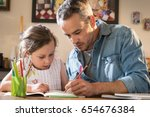 a father helps his little... | Shutterstock . vector #654676384
