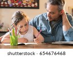 a father helps his little... | Shutterstock . vector #654676468