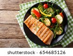 salmon grilled with zucchini... | Shutterstock . vector #654685126