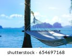 white hammock with clear blue... | Shutterstock . vector #654697168