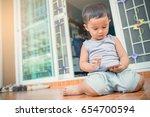 young asian little boy adorable ... | Shutterstock . vector #654700594