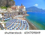 blue rows of beach umbrellas... | Shutterstock . vector #654709849
