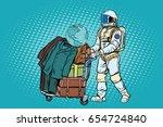 astronaut traveler with baggage ... | Shutterstock .eps vector #654724840