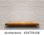 empty wooden shelf on old white ... | Shutterstock . vector #654739108