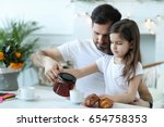 family. father with daughter at ... | Shutterstock . vector #654758353