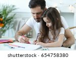 family. father with daughter at ... | Shutterstock . vector #654758380