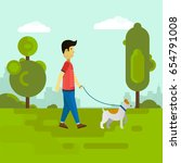 young man walking with dog in... | Shutterstock . vector #654791008