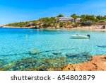 boat on turquoise sea in cala... | Shutterstock . vector #654802879