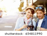 smiling couple with the camera | Shutterstock . vector #654811990