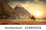 Nomad On Camel Near Pyramids I...