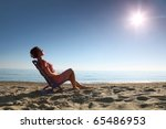 woman sits on  plastic chair on ... | Shutterstock . vector #65486953