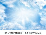 bright sun shining in clouds | Shutterstock . vector #654894328