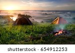 tents and bonfire in steppe... | Shutterstock . vector #654912253