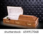 Stock photo opened wooden brown sarcophagus with a red roses isolated on gray luxury background casket coffin 654917068