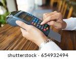 man using cashless terminal for ... | Shutterstock . vector #654932494