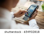close up of man using payment... | Shutterstock . vector #654932818