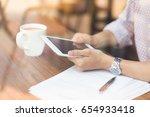 hands of businessman holding... | Shutterstock . vector #654933418