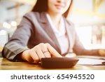 asian business woman using a... | Shutterstock . vector #654945520