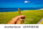 Small photo of Cannabis Blunt at the Ocean