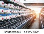 rolls of industrial cotton... | Shutterstock . vector #654974824