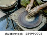 close up of potter's hands with ... | Shutterstock . vector #654990703