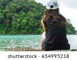 young woman sitting on rock.... | Shutterstock . vector #654995218