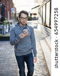 young asian man wearing glasses ... | Shutterstock . vector #654997258