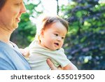 happy baby boy outside with his ... | Shutterstock . vector #655019500