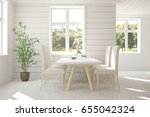 white dinner room with green... | Shutterstock . vector #655042324