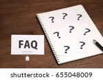 faq on a piece of paper and... | Shutterstock . vector #655048009