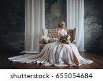 beautiful bride in a cream... | Shutterstock . vector #655054684