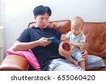 father using smartphone  baby... | Shutterstock . vector #655060420