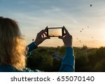 female taking image of air... | Shutterstock . vector #655070140