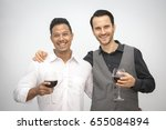 people holding wine together... | Shutterstock . vector #655084894