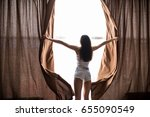 woman  wake up and open the... | Shutterstock . vector #655090549