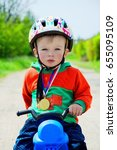 toddler on pushbike with medal... | Shutterstock . vector #655095109