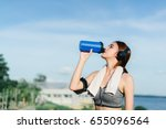 Small photo of Young girl asian drinking protein shake nutrition and listen music after exercise running workout outdoor at beach seaside in summer for muscle building and slim fit body nice strong perfect.