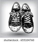 black canvas sneakers hand... | Shutterstock .eps vector #655104760