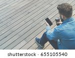 back view. hipster man is... | Shutterstock . vector #655105540