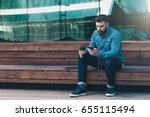 young attractive hipster man...   Shutterstock . vector #655115494