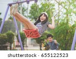 asian children swinging on the... | Shutterstock . vector #655122523