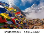 Prayer flags and Mt. Annapurna I background from Annapurna Base Camp ,Nepal.