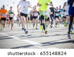 marathon runners in the city  | Shutterstock . vector #655148824