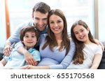 happy family at home  | Shutterstock . vector #655170568