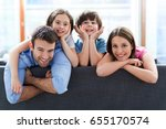 happy family at home  | Shutterstock . vector #655170574