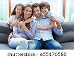 happy family at home  | Shutterstock . vector #655170580