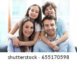 happy family at home  | Shutterstock . vector #655170598
