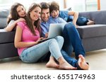 family using laptop at home  | Shutterstock . vector #655174963