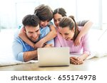 family using laptop at home  | Shutterstock . vector #655174978