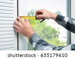 young man installing window... | Shutterstock . vector #655179610